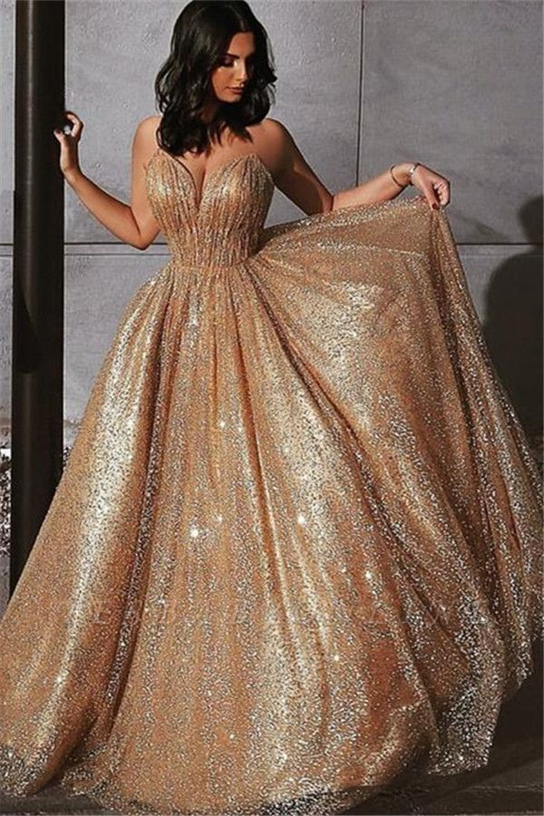 Champagne Elgant A-line Spaghetti Straps Backless Sequins Long Prom Dress